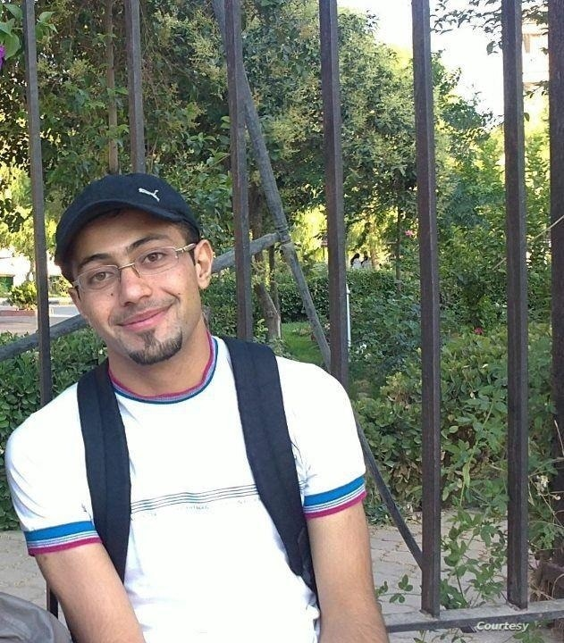 Maimouna al-Ammar's brother, Suhaib, an English literature student at Damascus University at the time, sits in his college's park before his arrest by the Syrian government in 2012. Suhaib has been detained for 8 years. (Courtesy: Maimouna al-Ammar)