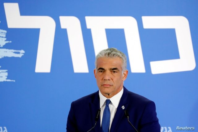 Yair Lapid, head of Yesh Atid holds a news conference together with Benny Gantz, head of Resilience party (not seen) to…