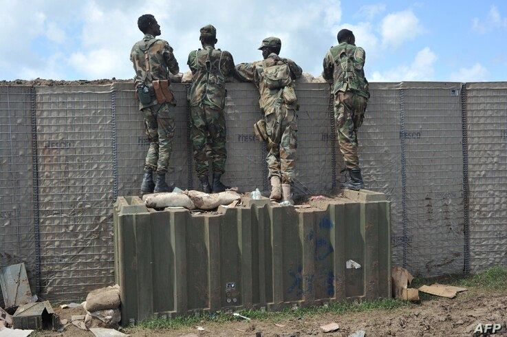 Somali soldiers are on patrol at Sanguuni military base, where an American special operations soldier was killed by a mortar…