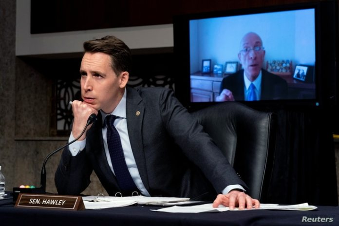 Sen. Josh Hawley, R-Mo., left, testifies via teleconference to former Sergeant in Arms Paul Irving during the Senate...