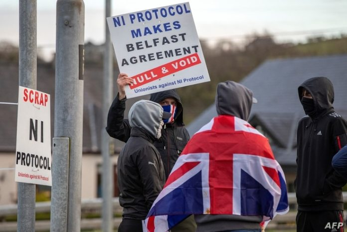 Pro-union loyalists demonstrate against the Northern Ireland protocol implemented after Brexit, on the road leading to the ...