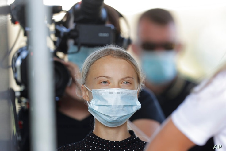 Climate activist Greta Thunberg arrives for a news conference following a meeting with German Chancellor Angela Merkel in…