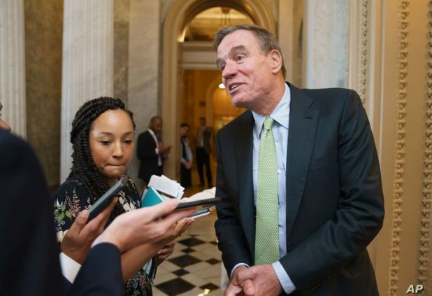 Sen. Mark Warner, D-Va., the Senate Intelligence Committee chairman, pauses for reporters during votes at the Capitol in…