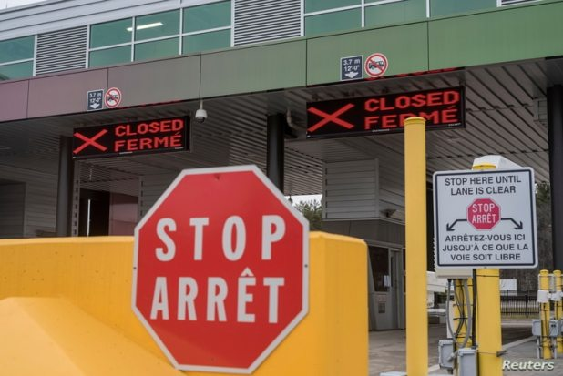 FILE PHOTO: Two closed Canadian border checkpoints are seen after it was announced that the border would close to