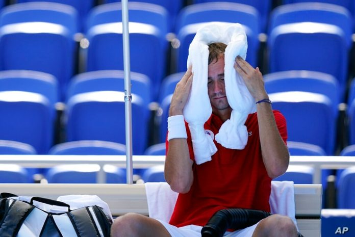 Daniil Medvedev of the Russian Olympic Committee, calm during a change in a tennis match against Alexander Bublik...