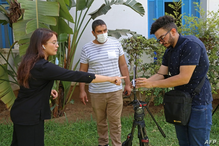 Al Jazeera journalists go live from  the National Syndicat (SNJT) headquarters in the Tunisian capital Tunis on July 26, 2021. …