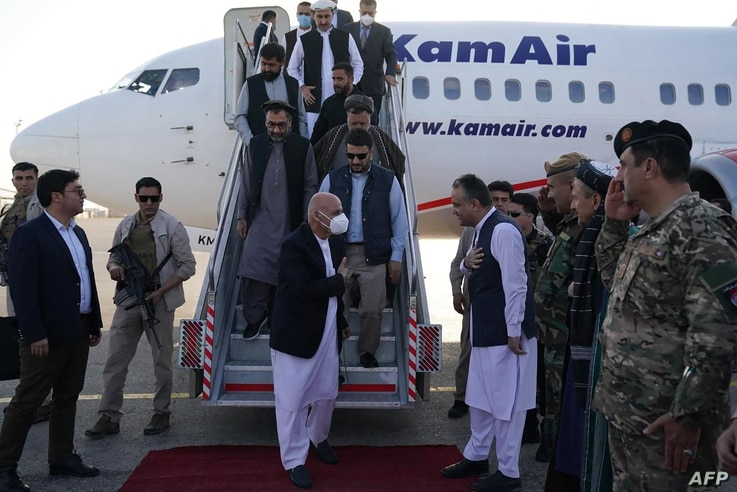 In this handout picture taken on August 11, 2021 and released by the Press Office of President of Afghanistan shows Afghanistan…