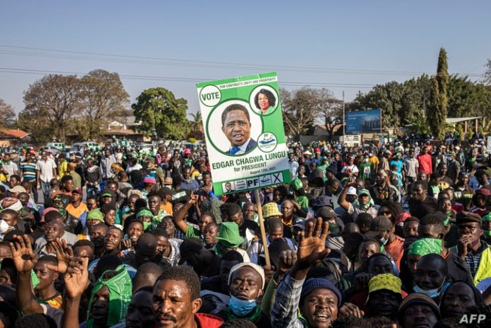Supporters of the leader of the ruling Zambia Patriotic Front, incumbent president and candidate Edgar Lungu gather in Lusaka,…