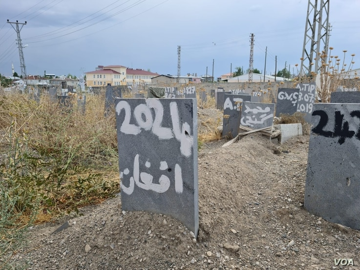 """n a area of a graveyard set aside for the bodies of refugees found dead as they attempt to find safety, this grave says simply: """"Afghan"""" on April 12, 2021 in Van, Turkey. (VOA/Heather Murdock)"""