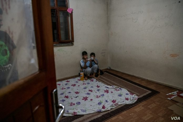Two families, a total of 12 people, live in this unfurnished apartment in Van, Turkey after August 10, 2021, fleeing Afghanistan.  (VOA/Claire Thomas)