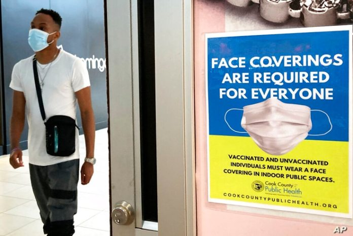 File-In this file photo from August 26, 2021, a department store in Rosemont, Illinois displays an information sign. summer……