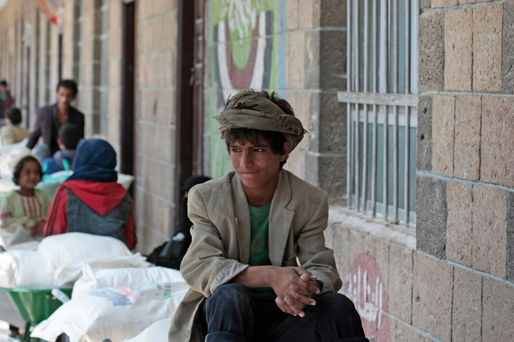 A boy waits for food supplies provided by the World Food Programme at a school in Sanaa, Yemen, Sunday, Aug. 25, 2019. The U.N…