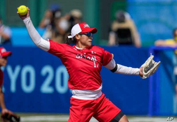 Japan's Yukiko Ueno pitches during the softball game between Japan and Australia at the 2020 Summer Olympics, Wednesday, July…