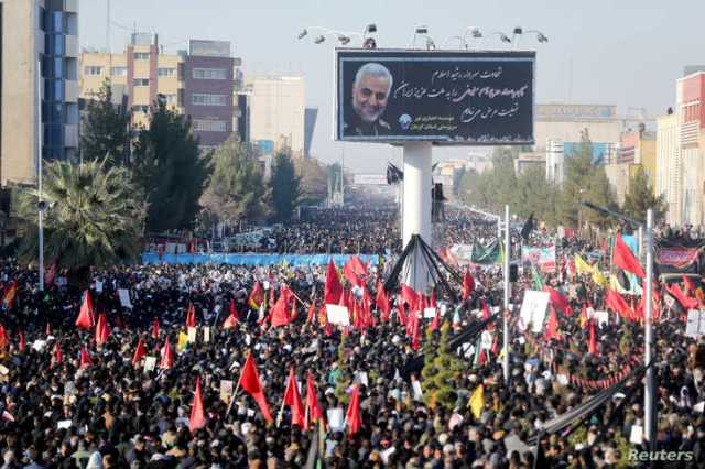 Iranian people attend a funeral procession and burial for Iranian Major-General Qassem Soleimani, head of the elite Quds Force,…