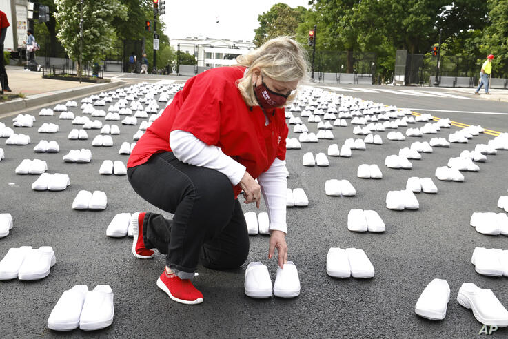 IMAGE DISTRIBUTED FOR NATIONAL NURSES UNITED - National Nurses United president Jean Ross places shoes to honor the hundreds of…