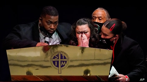 Katie and Aubrey Wright, parents of Daunte Wright, cry as the speak during funeral services of Daunte Wright at Shiloh Temple…