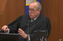 In this image from video, Hennepin County Judge PeterCahill dresses the court after the judge put the trial into the hands of…