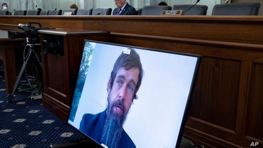 Twitter CEO Jack Dorsey appears on a screen as he speaks remotely during a hearing before the Senate Commerce Committee on Capitol Hill, Oct. 28, 2020, in Washington.