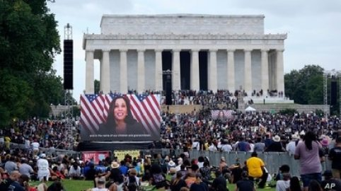 A screen displays a video with Democratic vice presidential candidate Kamala Harris speaking during the March on Washington, Aug. 28, 2020, at the Lincoln Memorial in Washington.