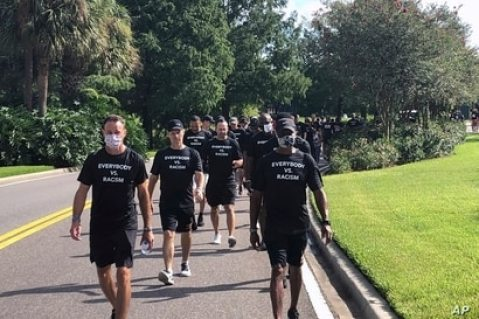 NBA referees march in support of players seeking an end to racial injustice, in Lake Buena Vista, Florida, Aug. 27, 2020.