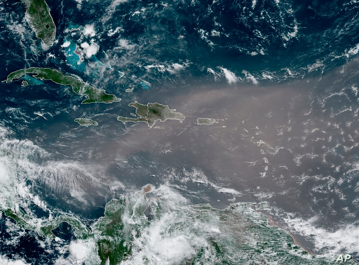 This satellite photo provided by the National Oceanic and Atmospheric Administration, NOAA, shows a could of dust coming from…