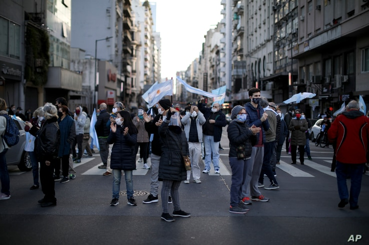 Protesters demand the end of the government-ordered lockdown to curb the spread of the new coronavirus in Buenos Aires,…