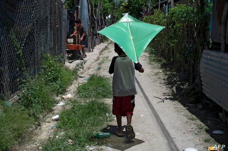 A boy plays wih a kite at the December 1 community in Soyapango, El Salvador, on July 30, 2020, amid the new coronavirus…