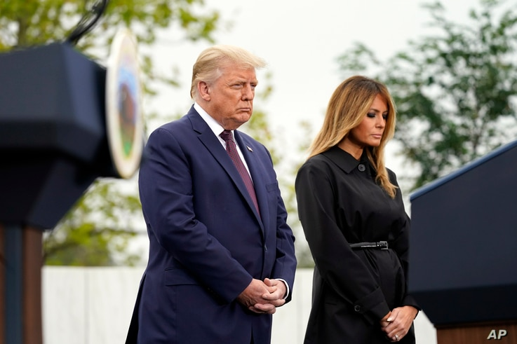 President Donald Trump and first lady Melania Trump listen during a prayer at a 19th anniversary observance of the Sept. 11…