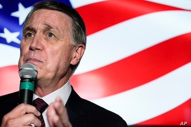 FILE - In this Nov. 13, 2020 file photo, candidate for U.S. Senate Sen. David Perdue speaks during a campaign rally, in Cumming, Ga.
