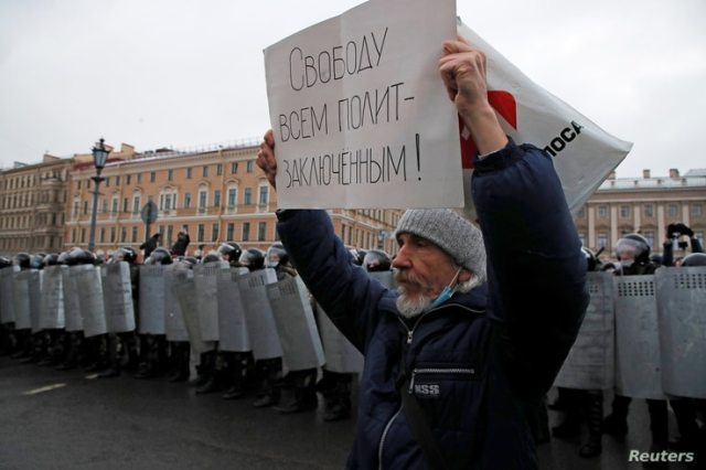 "A demonstrator holds a placard reading ""Freedom for all political prisoners"" during a rally in support of jailed Russian…"