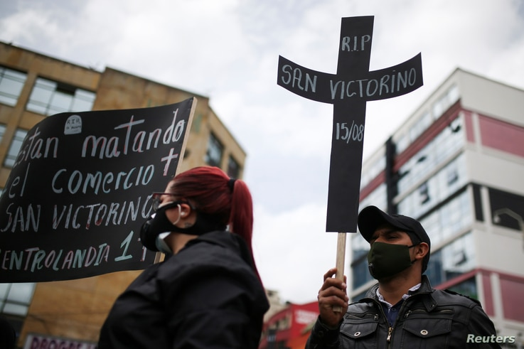 Merchants in the San Victorino sector wearing face masks, protest against the new quarantine measures taken by the mayor's office, amidst an outbreak of the coronavirus disease (COVID-19), in Bogota