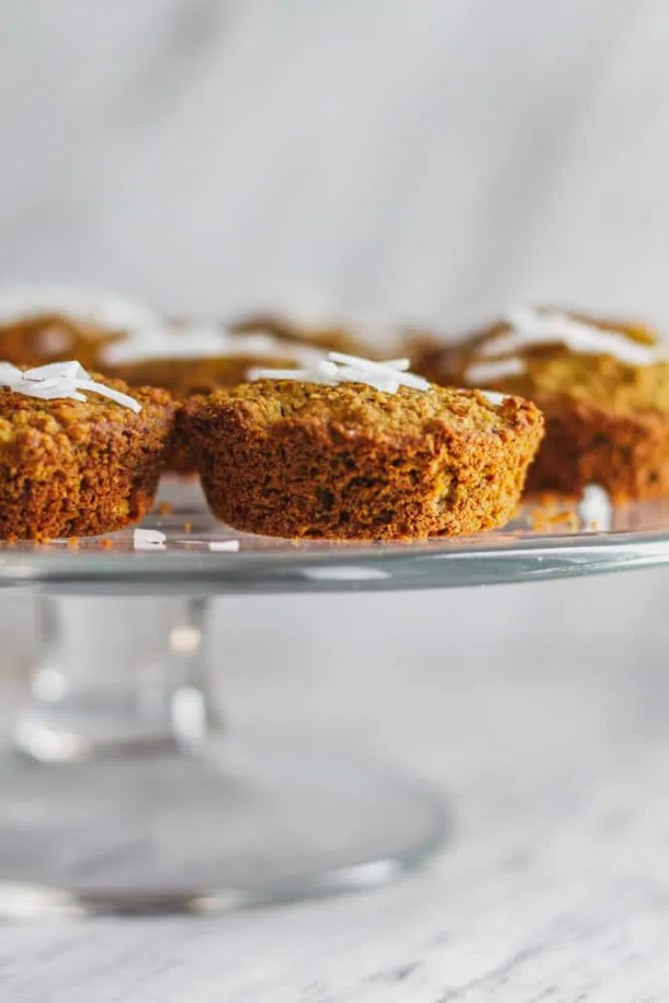 vegan breakfast muffins on cake platter with coconut flakes
