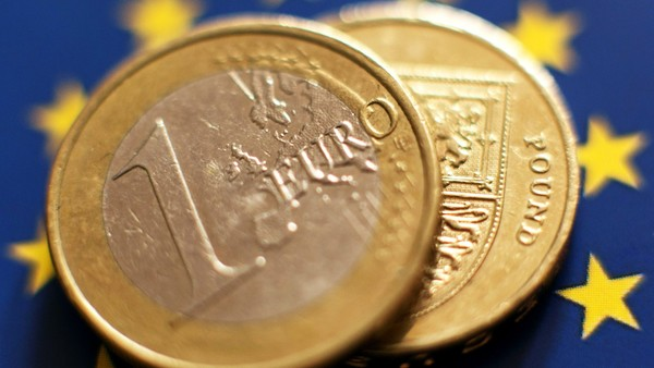 File photo dated 21/05/16 of a 1 euro coin and a One Pound coin placed on a backdrop of The European flag, as Sterling found some respite in overnight trading on Tuesday after taking a Brexit battering that saw it fall to a 31-year low. PRESS ASSOCIATION Photo. Issue date: Tuesday June 28, 2016. The pound rose 0.7% to 1.33 dollars, a rebound from Monday's 1.31 dollars, its lowest level since 1985. See PA story CITY Pound. Photo credit should read: Yui Mok/PA Wire