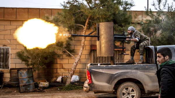 "A Kurdish People's Protection Units (YPG) fighter fires an anti-aircraft weapon at Islamic State fighters in Tel Tawil village, Syria, in this February 25, 2015 file photo. A conference underway in Kurdish-controlled northern Syria aims to approve a ""Federal Democratic"" system of government for the area. REUTERS/Rodi Said/Files"