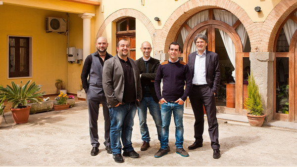 Sardex's founders outside their office in Serramanna, Sardinia