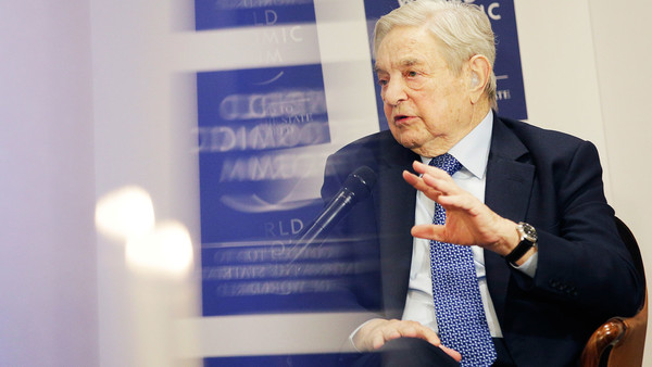George Soros, billionaire and founder of Soros Fund Management LLC, gestures as he speaks during an interview at the World Economic Forum (WEF)in Davos, Switzerland, on Thursday, Jan. 21, 2016. World leaders, influential executives, bankers and policy makers attend the 46th annual meeting of the World Economic Forum in Davos from Jan. 20 - 23. Photographer: Matthew Lloyd/Bloomberg *** Local Caption *** George Soros