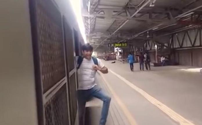 Three young men from Virar seen in a video performing Kiki challenge have been directed by a railway  Three Youths Doing Kiki Stunt In Mumbai Local, Asked To Clean Railway Station three young men from virar seen in a video performing kiki challenge have been directed by a railway 1533799868