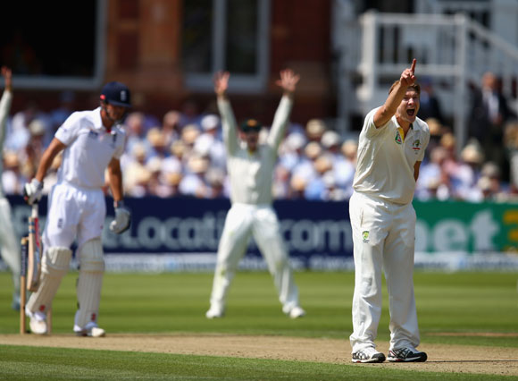 Shane Watson of Australia celebrates after taking the wicket of Alastair Cook of England