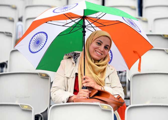 PIX: Rain Halts India's Charge Against New Zealand
