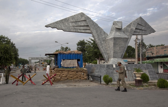 A paramilitary soldier walks near the main entrance of the Minhas base in the town of Kamra