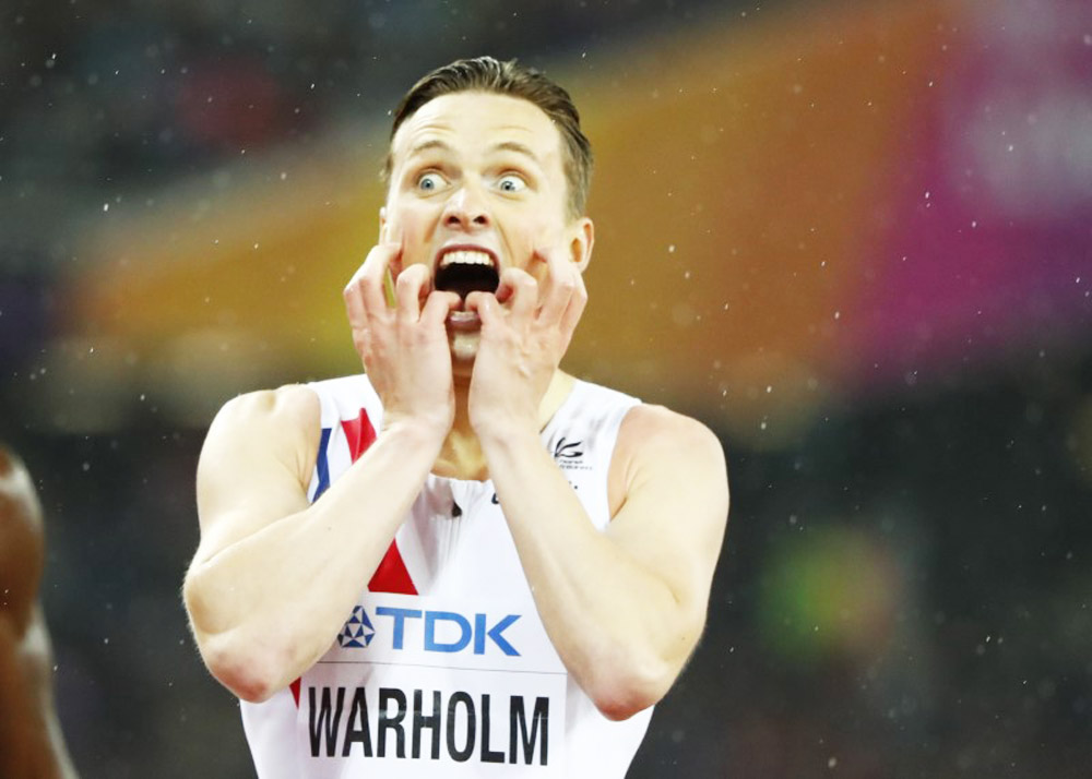 Norway'a Karsten Warholm reacts after winning the Men's 400 Metres Hurdles final at the World Athletics Championships at London Stadium, in London on Wednesday