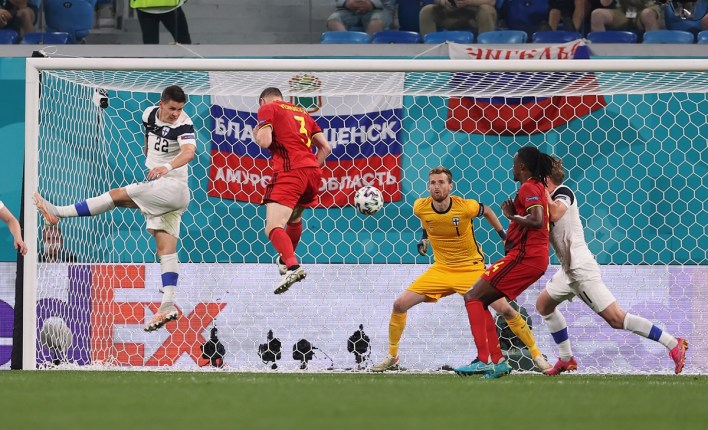 Belgium's Thomas Vermaelen heads on target before Finland goalkeeper Lukas Hradecky makes a mess of the collection and concedes and own goal.