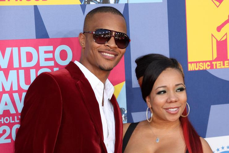 1501602195 be17b0078f57b1cf5028bb3a52b8c71e Tiny Defends T.I.s Integrity After Fan Calls Him Cheater