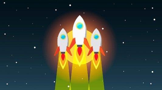 Tres cohetes en pleno lanzamiento.
