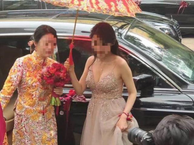 Phù dâu trễ nải khoe ngực khủng khiến cô dâu bị dìm hàng không thương tiếc