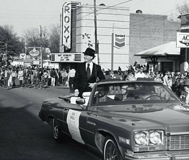 Paul_harvey_riding_in_a_convertible_as_the_grand_marshal_of_a_christmas_parade_in_downtown_russellville_adah Jpg