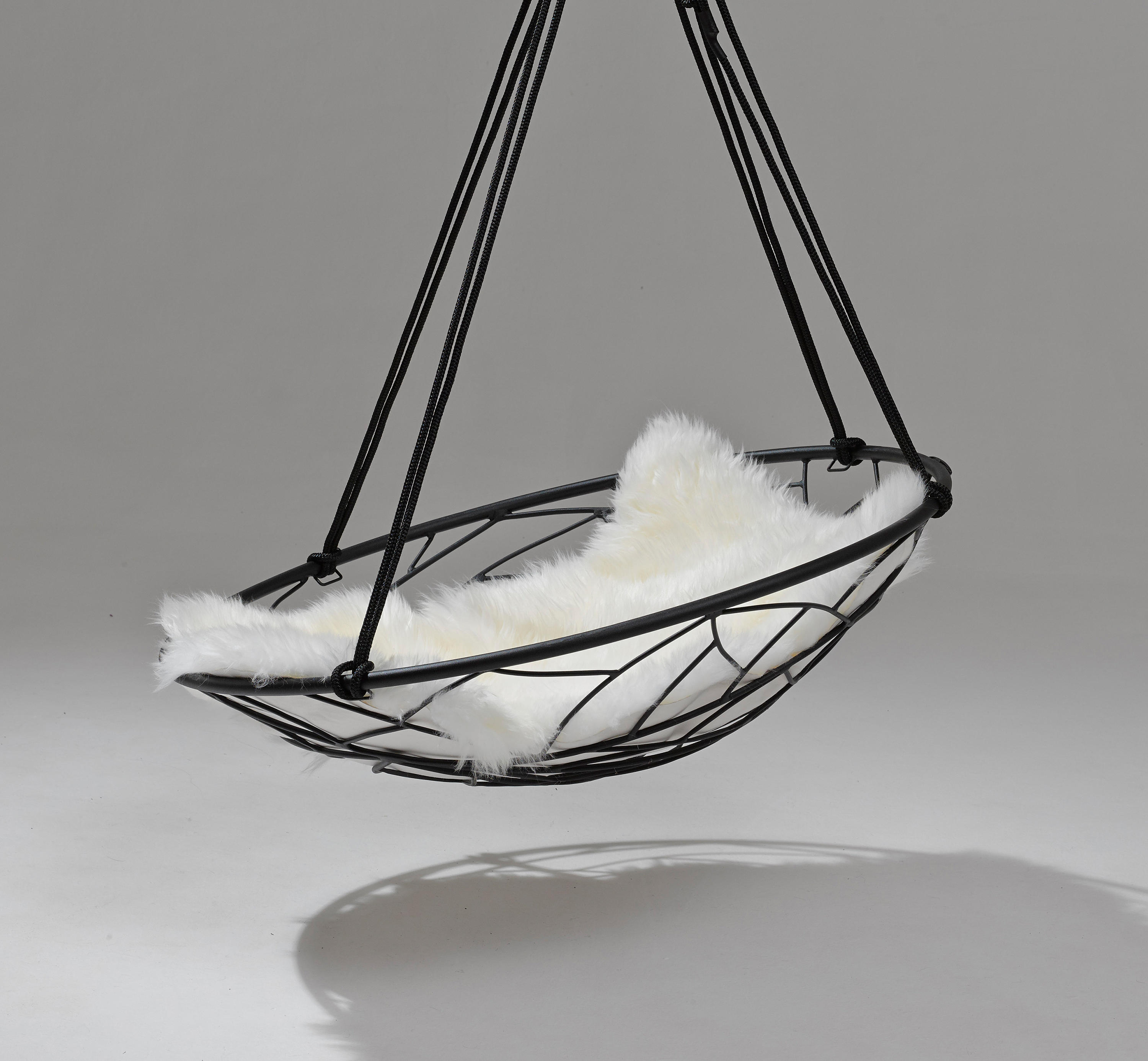 swing seat johannesburg wedding chair covers hire inverness sheepskin cushion cushions from studio stirling