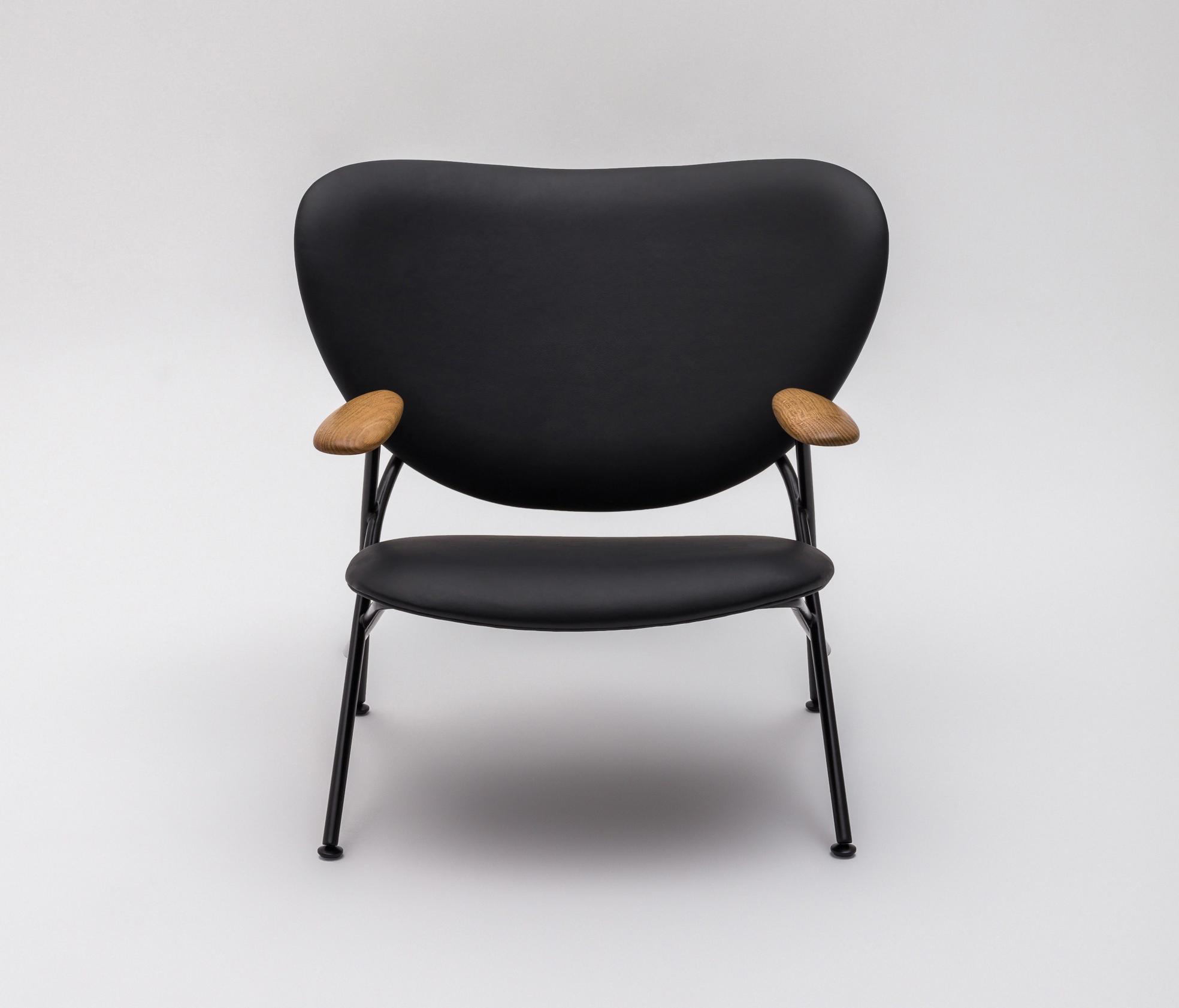 calder armchair with wooden