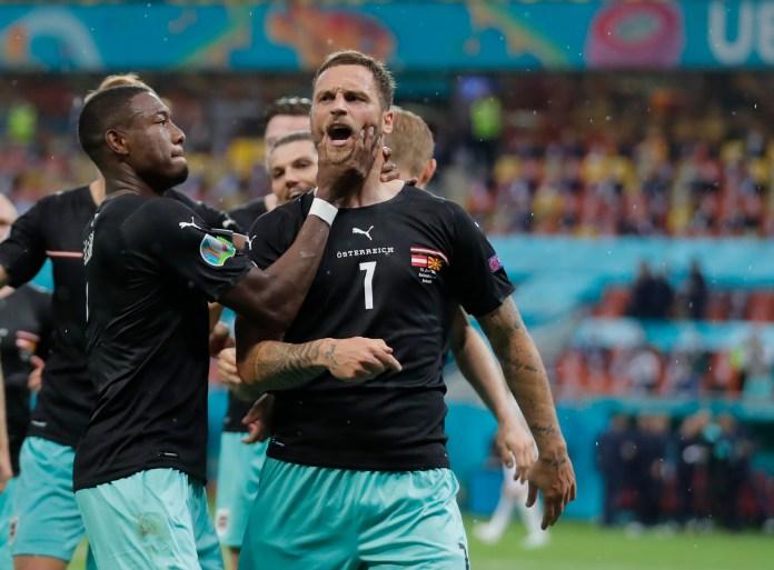 Marko Arnautovic (right) celebrates