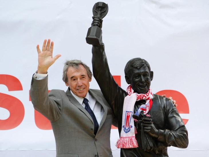 Gordon Banks stands next to his statue at the Britannia Stadium